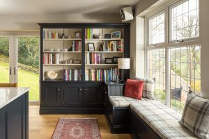 handcrafted furniture in the lounge of the house with a reading area