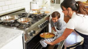 mother baking food with her child