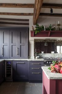 Handcrafted Kitchen with an Island. Luxury cabinetry. Kitchen with exposed beams.